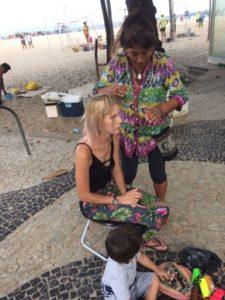 Having my hair braided on Copacabana beach